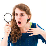 young woman through a magnifying glass