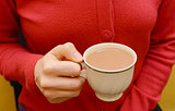 Cup of tea in a woman's hand