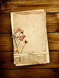 Old card on wooden planks