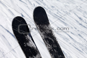 Skis over off-piste slope