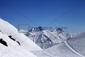 Ski resort with off-piste slope at nice sun day