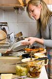 woman washing plates