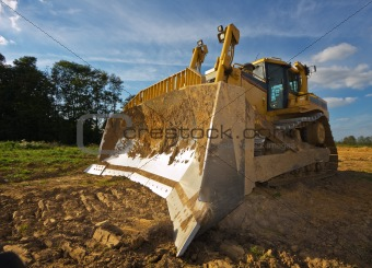 Dirty yellow bulldozer