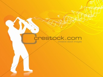 saxophone player silhouette in the orange lights
