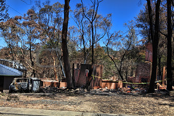 After the fire - burned houses and vehicles