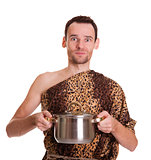 Wild man with cooked food in a stew pan