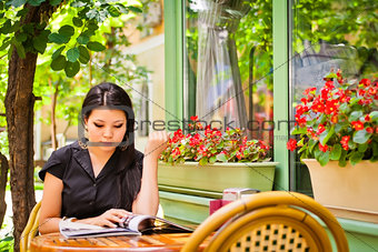Beautiful asian girl in cafe