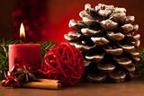 Pine cone and candle cristmas decoration