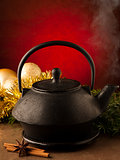 Christmas tea in old iron teapot