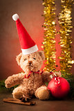 Teddy bear with red santa claus hat and christmas presents