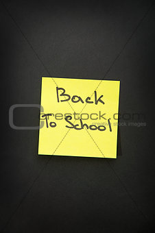 back to school sticker on black