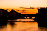 Ponte Vecchio sunset view over Arno  river in Florence
