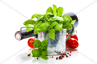 Fresh basil in the pot and italian ingredients