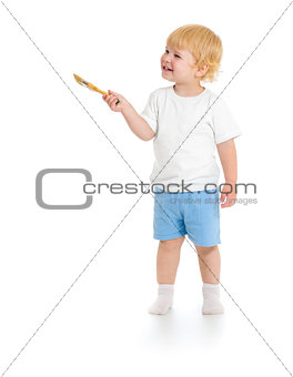 Baby boy with paint brush front view standing full length isolat