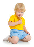 Kid boy eating ice cream isolated on white
