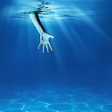Problem solving concept. Giving helping hand in sea underwater.