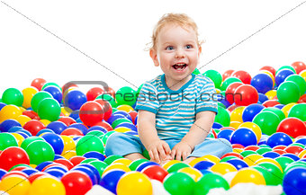 Happy kid playing colorful balls