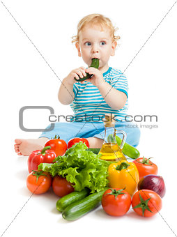 baby eating healthy food vegetables on white background
