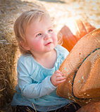 Adorable Baby Girl with Cowboy Hat at the Pumpkin Patch