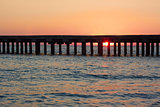 Old sea pier at sunset