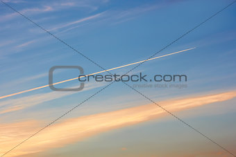 Aircraft track in the evening sky