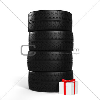 Four New Car Tires and White Gift with Red Ribbon On the White