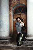 Retro styled fashion portrait of a young couple. Clothing and ma