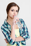 young female drinking water