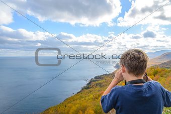 Boy taking photos