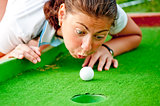 Girl cheating in the game of golf