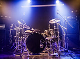 Drumkit on empty stage waiting for musicians