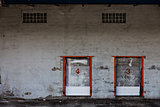 Old Grungy Industrial Garage Door with Graffitis.