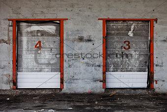 Old Grungy Industrial Garage Door with Graffitis.