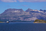 Ferry passing through fjord