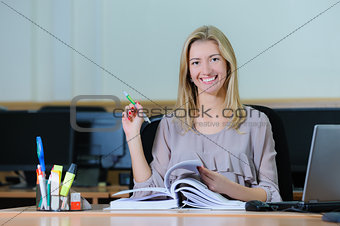 Beautiful Businesswoman holding a pen
