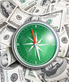 compass over hundred dollars. Finance concept.