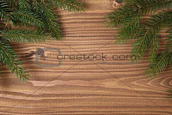 green spruce twig on wooden plank