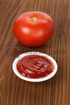 tomato sauce in bowl on wooden table