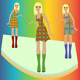 Fashion blond models posing on podium in checkered dresses