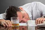 Sleeping man with drinking problems