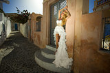 The beautiful bride in a wedding dress on Santorini in Greece.