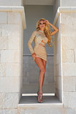 Beautiful blond woman with long legs in the fleshy crystal dress