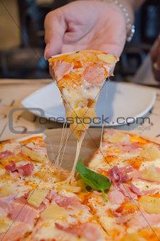 slice pizza in hand