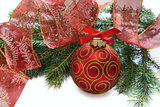 Christmas red ball, twig of fir , ribbon with drawing of tree an