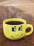 Yellow coffee mug with smile