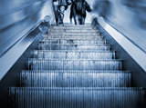 Underground Escalator with motion blur and blue tint