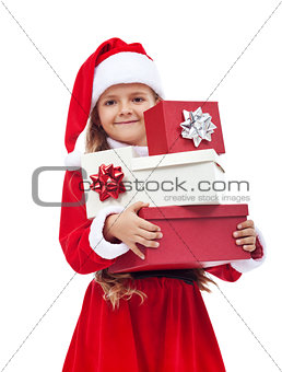 Little girl in santa costume holding presents