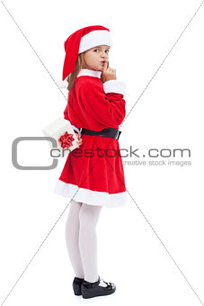 Girl in santa costume preparing a surprise
