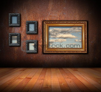 architectural backdrop with frames on grunge wall