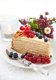 Piece of homemade honey cake decorated with fresh berries